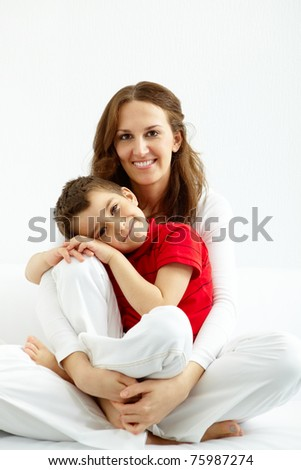 Cute lad and his mother having good time at home - stock photo