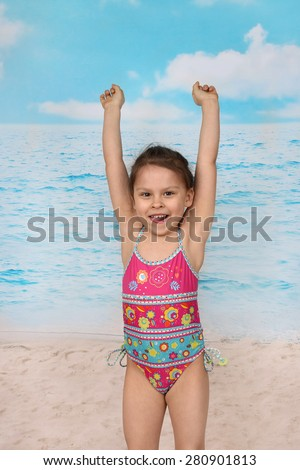 Cute little asian girl jumps on beach - summer, sun, sea, vacation, childhood concept - stock photo