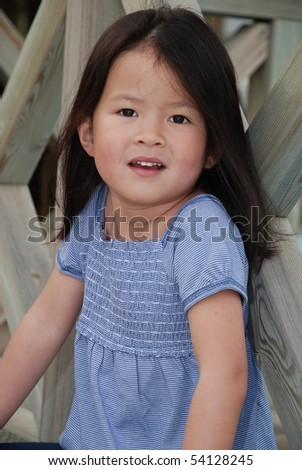 Cute little asian girl posing in the sun - stock photo