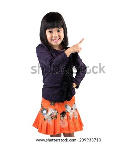 Cute little asian girl with index finger up, Isolated over white - stock photo