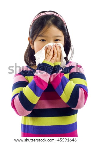 Cute little Asian girl with the flu - isolated over white - stock photo