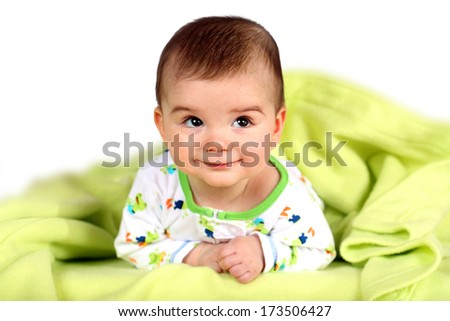 Cute little baby boy laying on a blanket - stock photo