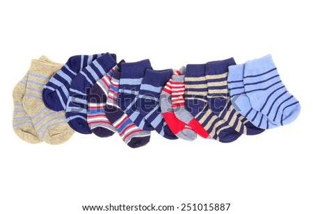 Cute little baby boy socks isolated on white. Small blue socks with stripes arranged in a line. - stock photo