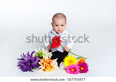 Cute little baby boy with the flower sitting .  isolated on white - stock photo