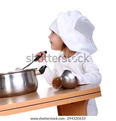 cute little baby dressed as a cook looking up - stock photo