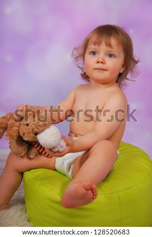 cute little baby girl playing with mascots - stock photo