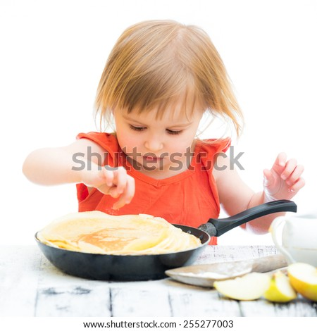 cute little baby girl with pancakes isolated on a white background - stock photo