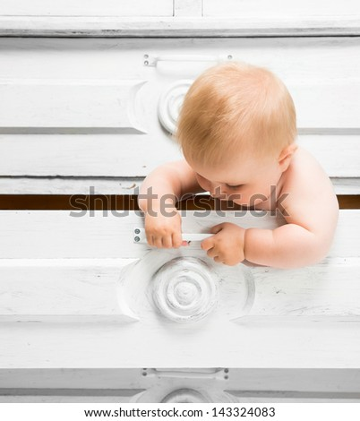 Cute little baby in a drawer - stock photo