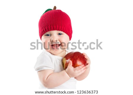 Cute little baby in a knitted apple hat biting in a red ripe apple, isolated on white - stock photo