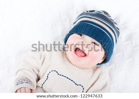 Cute little baby in a knitted hat and sweater - stock photo