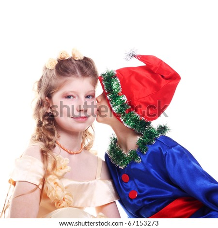 cute little baby kissing his sister in the festive dress - stock photo