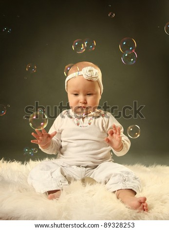 cute little baby with soap bubbles - stock photo