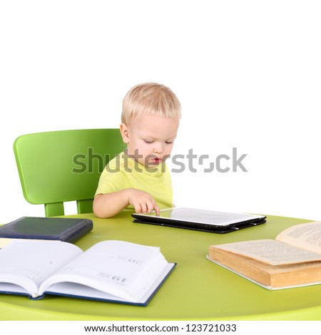 cute little baby with the tablet PC, books and diary - stock photo