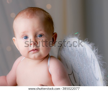 Cute little baby with wings. St. Valentine concept. Little Cupid. - stock photo