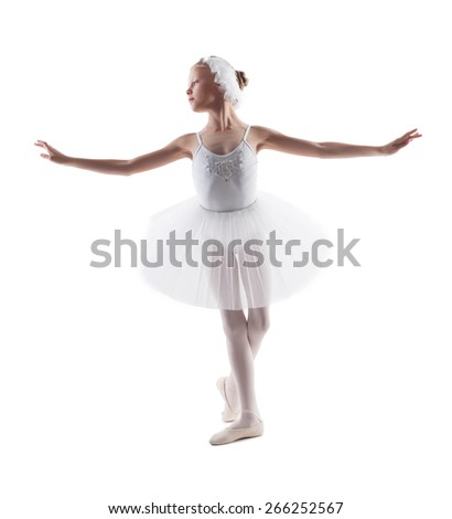 Cute little ballerina dancing role of white swan - stock photo