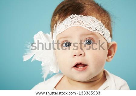 cute little ballerina on blue background - stock photo