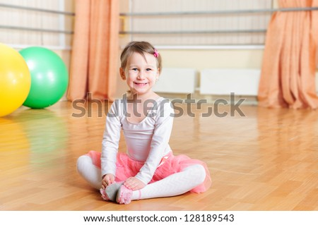 Cute little ballerina training at ballet class - stock photo