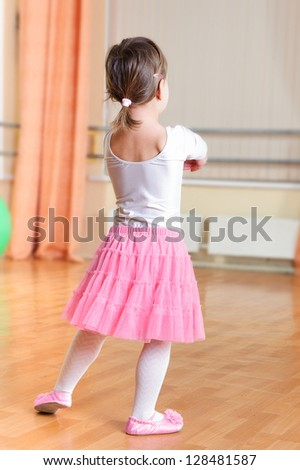 Cute little ballet dancer at training class - stock photo