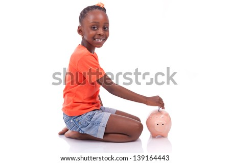 Cute little black girl inserting an euro bill inside a piggy bank, isolated on white background - African children - stock photo