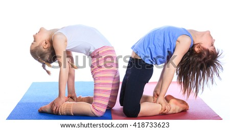Cute little boy and girl practice yoga. Isolated on the white background - stock photo