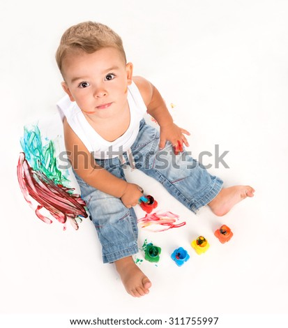 cute little boy and gouache above photo on white background - stock photo