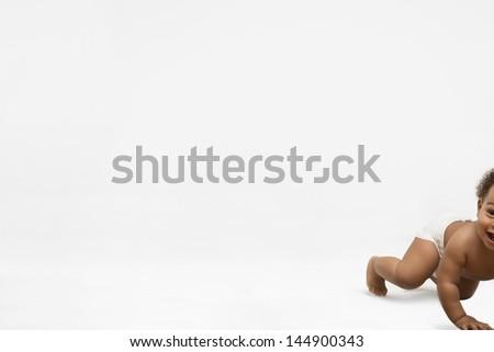 Cute little boy crawling on white background - stock photo