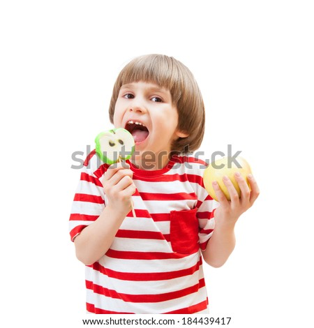 Cute little boy eats candy apple. Isolated on white background - stock photo