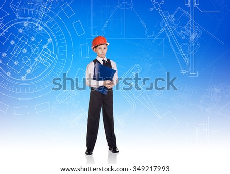 Cute little boy engineer stands on the blue background with plan - stock photo