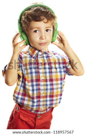 Cute little boy enjoying music using headphones. Little child with  green headphones isolated over white - stock photo