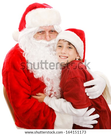Cute little boy gives Santa Claus a big hug.  Isolated on white.   - stock photo