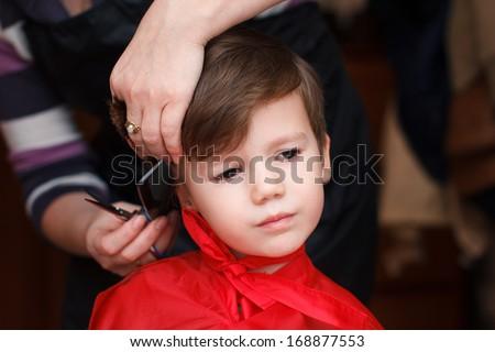 Cute little boy haircut - stock photo