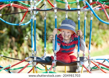 cute little boy having fun at the playground - stock photo