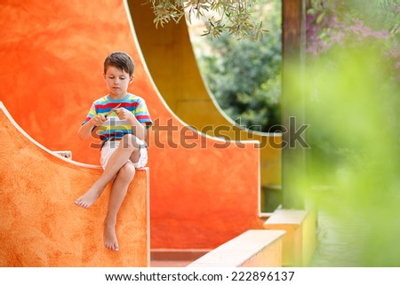 Cute little boy having fun outdoors on beautiful summer day - stock photo