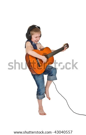 Cute little boy in blue jeans, headphones and bandanna playing guitar isolated on white. - stock photo