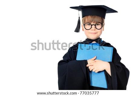 Cute little boy in graduation gown - stock photo