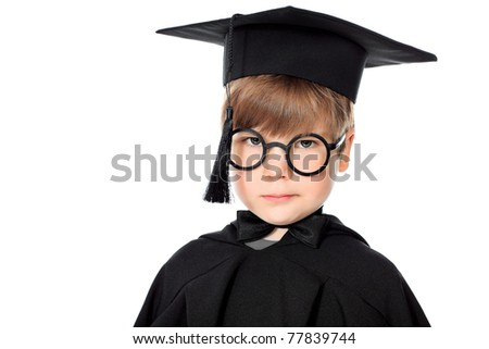 Cute little boy in graduation gown. Isolated over white background. - stock photo