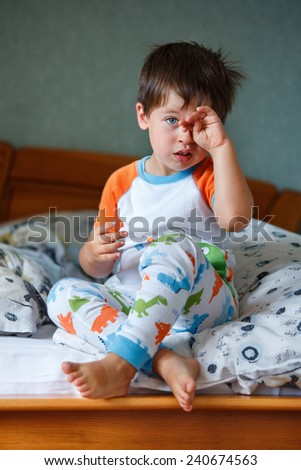 Cute little boy in pajamas on sunny morning - stock photo
