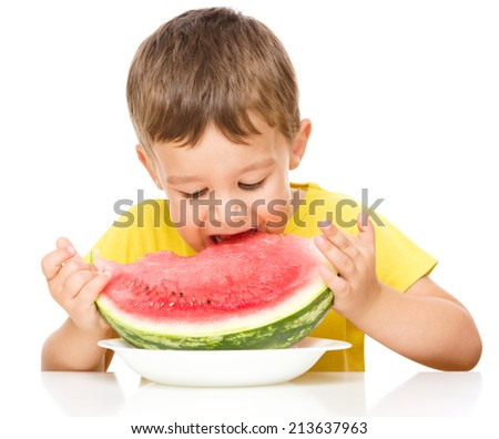 Cute little boy is eating watermelon, isolated over white - stock photo