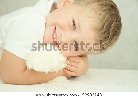 Cute little boy is huging a toy. - stock photo