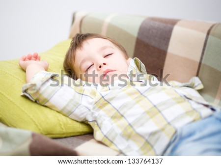 Cute little boy is sleeping - stock photo