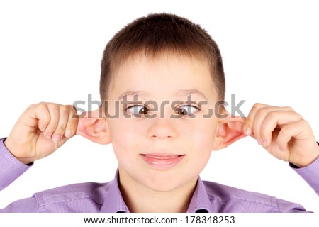 cute little boy making grimaces with his eyes and ears - stock photo