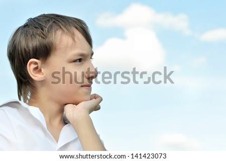 cute little boy on a light background - stock photo