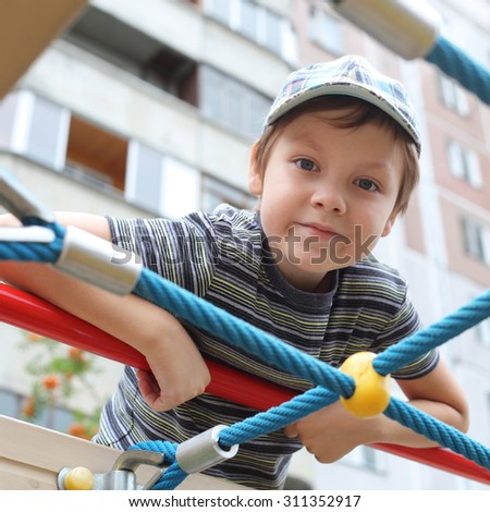 cute little boy on the playground - stock photo