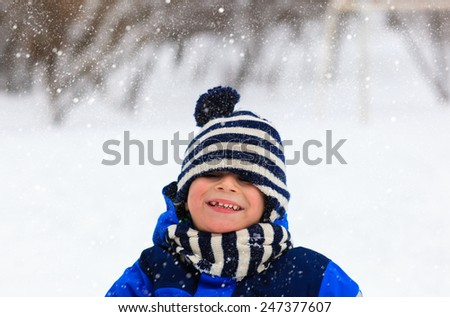 cute little boy outdoors on beautiful winter snow day - stock photo