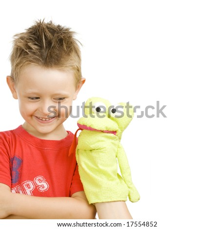 cute little boy playing with snake puppet - stock photo