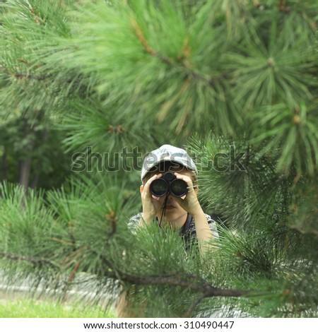 cute little boy playing with the binocular - stock photo