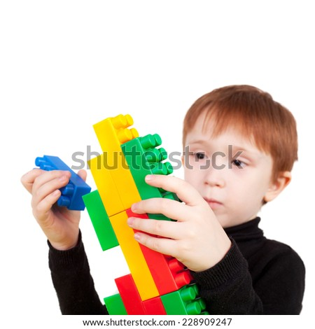 cute little boy playing with the bricks - stock photo