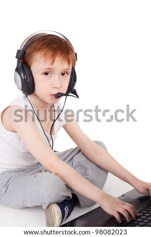 cute little boy playing with the computer - stock photo