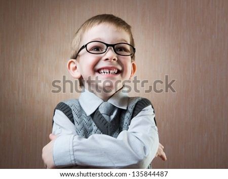 Cute little boy portrait over dark background - stock photo