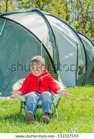 Cute little boy resting in camping great outdoors - stock photo